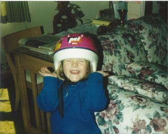Toddler Taylor Excitedly Wearing a Bike Helmet