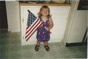 Toddler Taylor Holding An American Flag