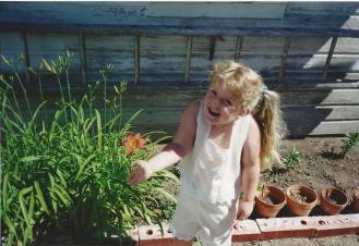 Toddler Taylor Excited About a Flower