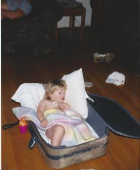 Toddler Taylor Napping in a Suitcase