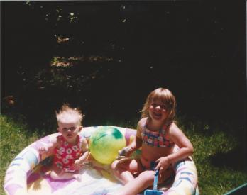 Toddler Taylor And Her Sister At the Pool